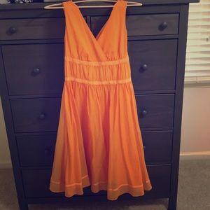 Flowing tangerine dress